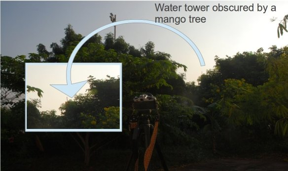 A mango tree obscures my reference object - a water tank on the building next door
